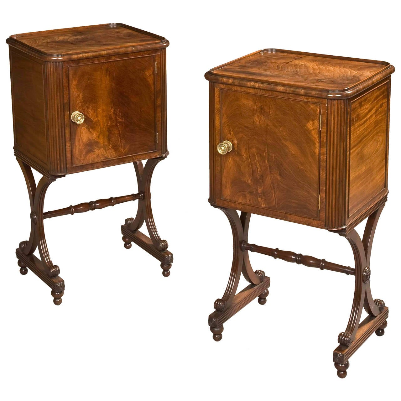 Pair of English 'X' Form Mahogany Cupboards of the Regency Period