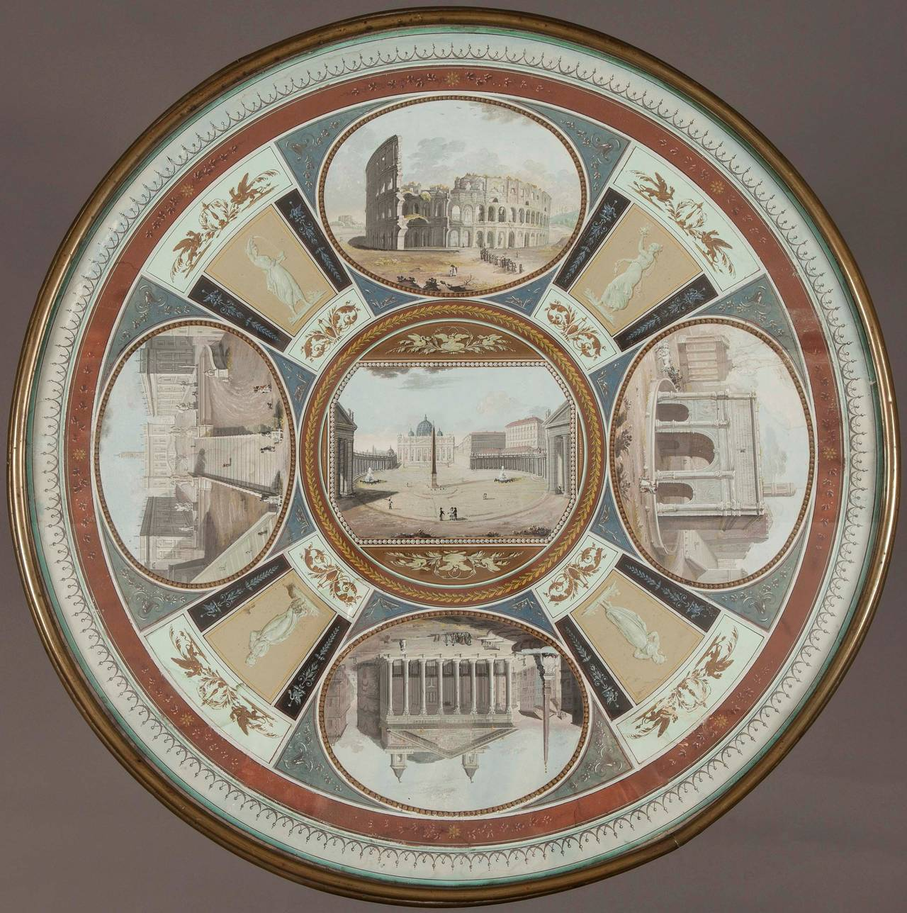 Constructed in a good flame-veneer mahogany, with gilt metal mounts; rising from a tripartite incurved base mounted on castors, issuing three entasis form cylindrical columns, gilt metal mounted at their capitols and bases, which support the