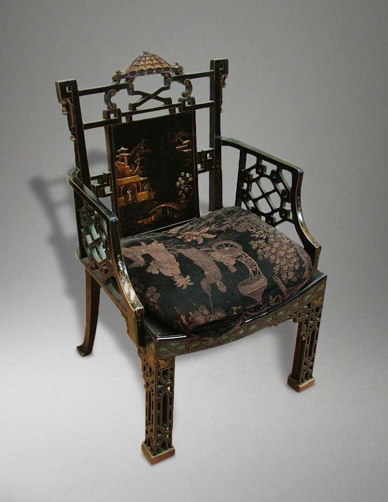 An armchair in the 'Chinese Chippendale' manner.    The design for the frame of this chair is drawn from Plate XXVII in Thomas Chippendale's 'The Gentleman and Cabinet Maker's Directory; having square block footed front legs with extensive