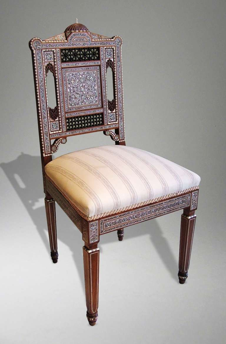 A rare Syrian side chair of the very finest quality   The carcase in solid Sandalwood and rising from gently tapered legs; the carved and pierced back having mashrebeyeh style panels using turned ivory and Sandalwood, with a lobed domed top,