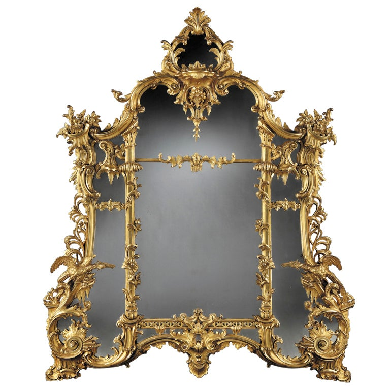 An Antique Giltwood Mirror of Substantial size in the Rococo Chippendale Manner 1