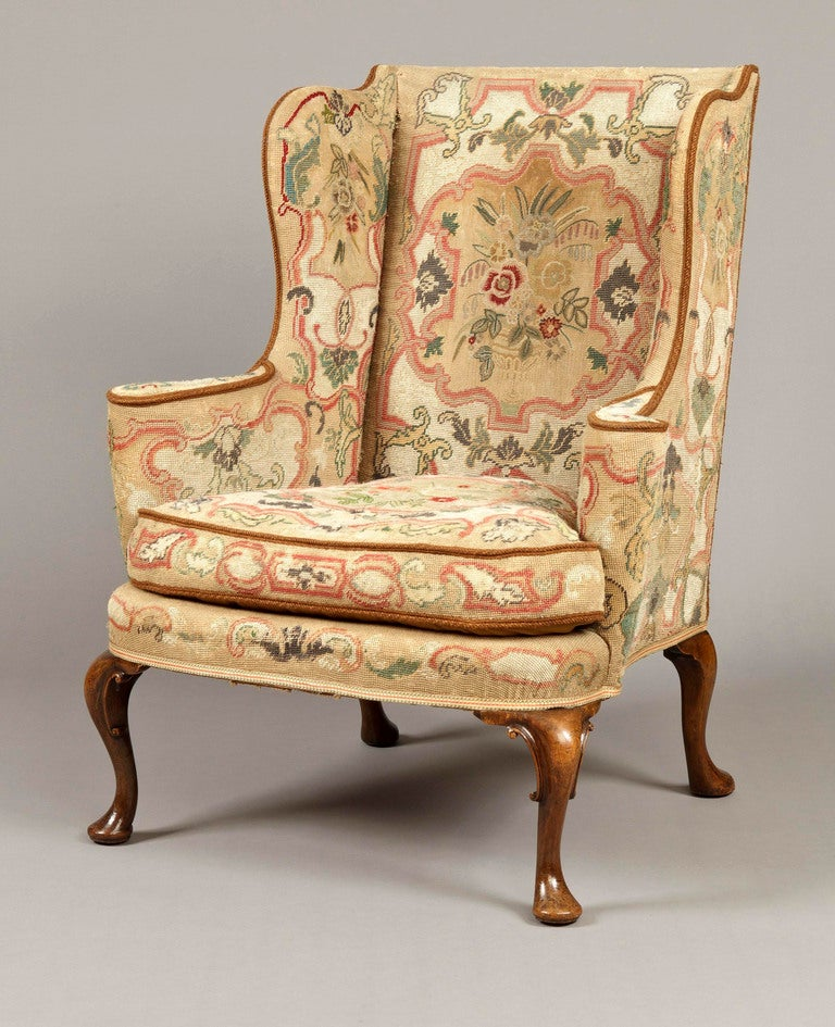 Pair of antique wing backed armchairs in the mid georgian manner at