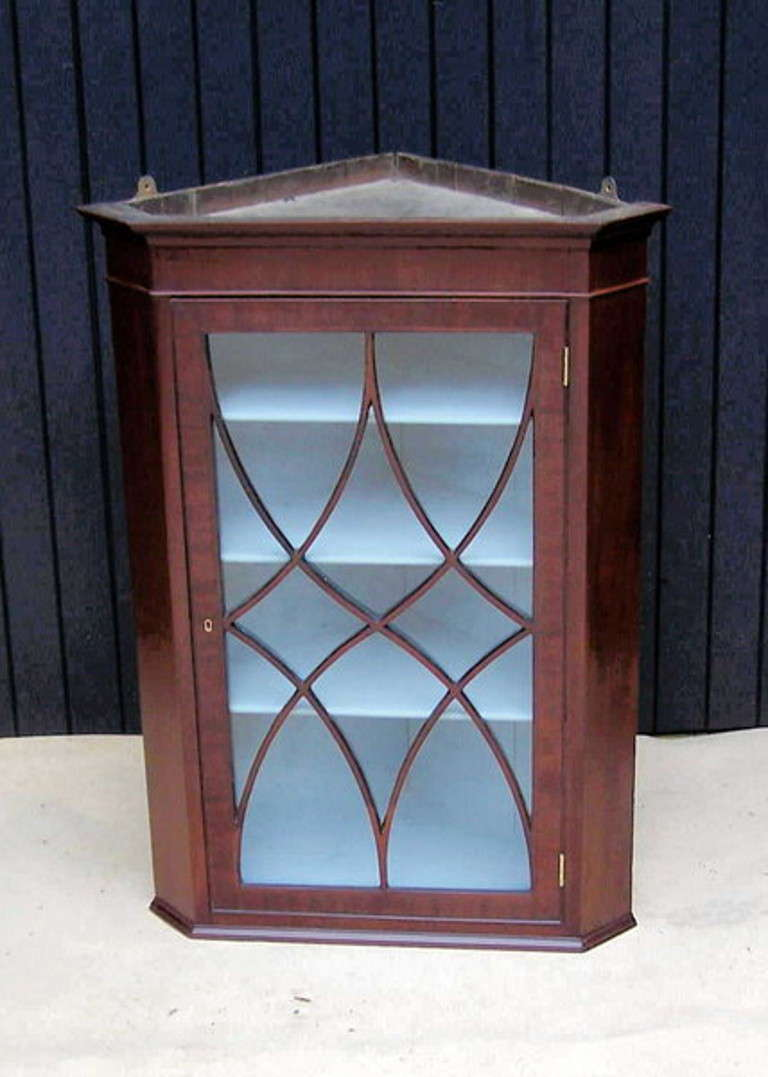 A Very Attractive George III Period Mahogany Wall Hanging Corner Cabinet Having Ebonised Inlay  Decoration And Astragal Glazed Door  (An elegant and practical piece of furniture this corner cupboard is perfect for displaying those items which you