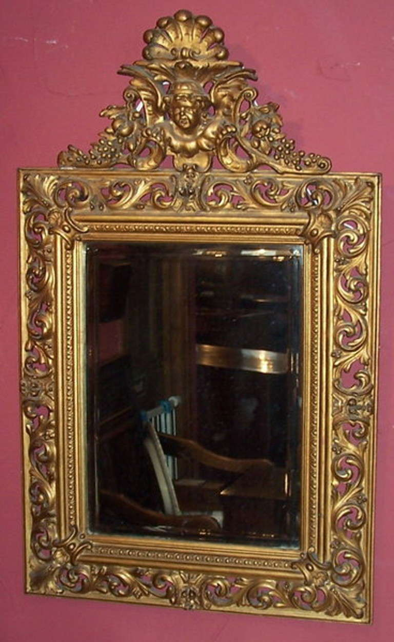A 19th century Italian wall mirror with carved frame and bevelled glass plate.