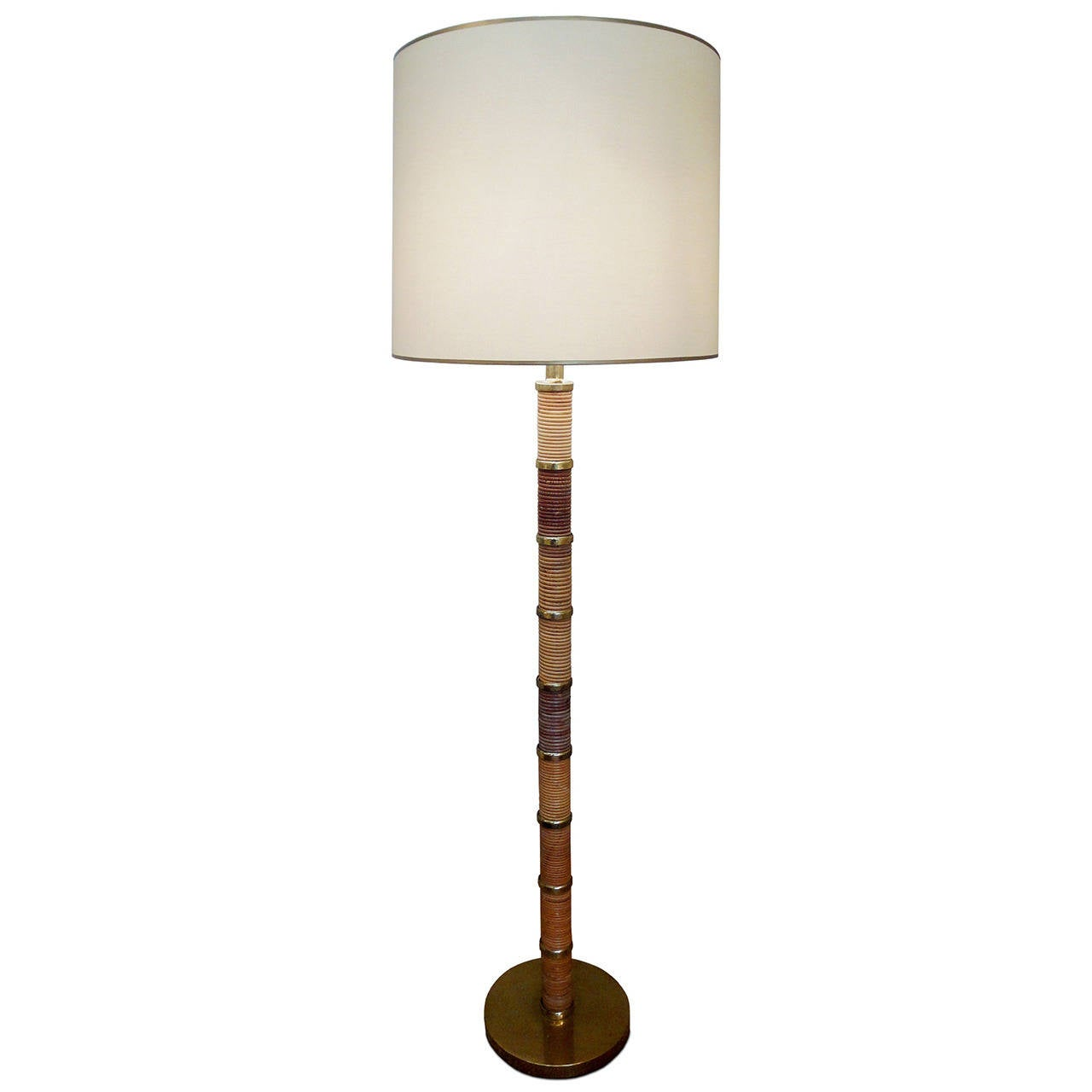 Mid Century Style A Brass And Rattan Floor Lamp At 1stdibs