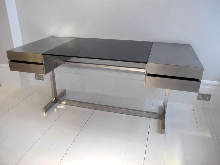 A very rare four drawer stainless steel and glass desk by for Table armoire inox