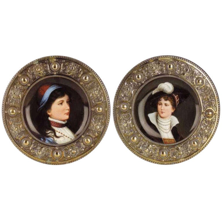 Pair of antique Austrian circular painted porcelain plaques with brass frames