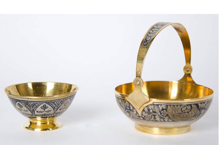 The finely wrought 18 piece parcel gilt service, decorated with Russian rinceau motifs in the Niello technique  The Niello technique dates to the time of the ancient Egyptians, who are credited with its creation. Spreading throughout Europe during