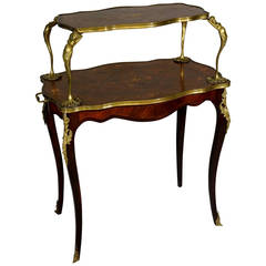 A fine Louis XV style ormolu mounted marquetry two-tier table