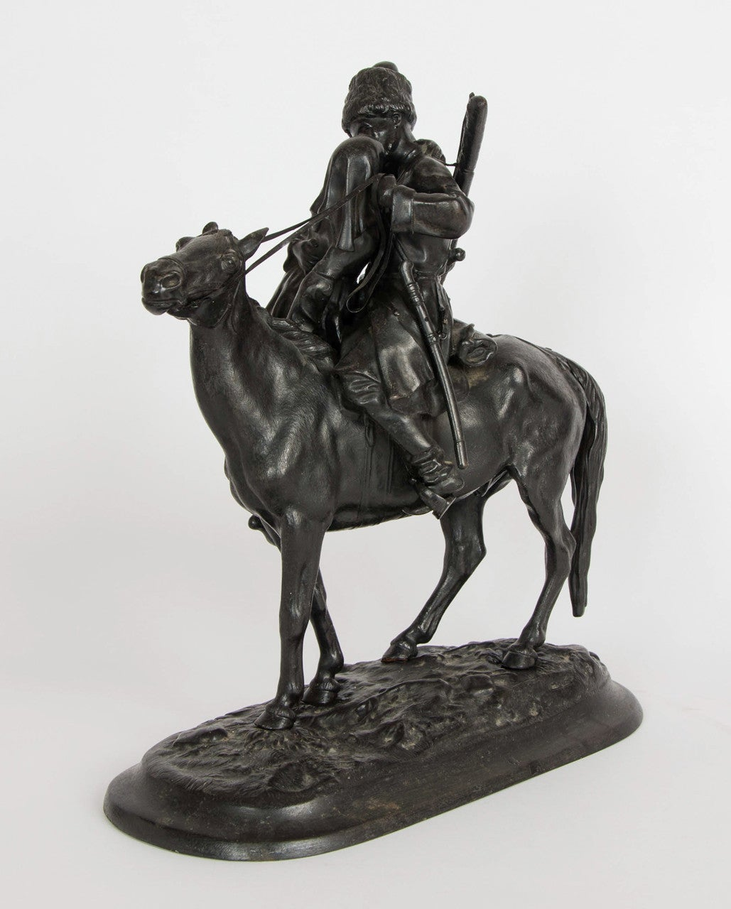 The cossack interlaced in a woman's arms on the verge of kissing whilst on the horse.