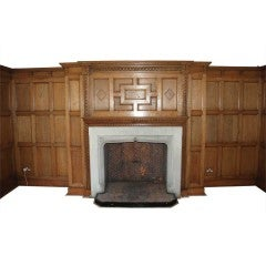 An oak panelled room with stone fireplace