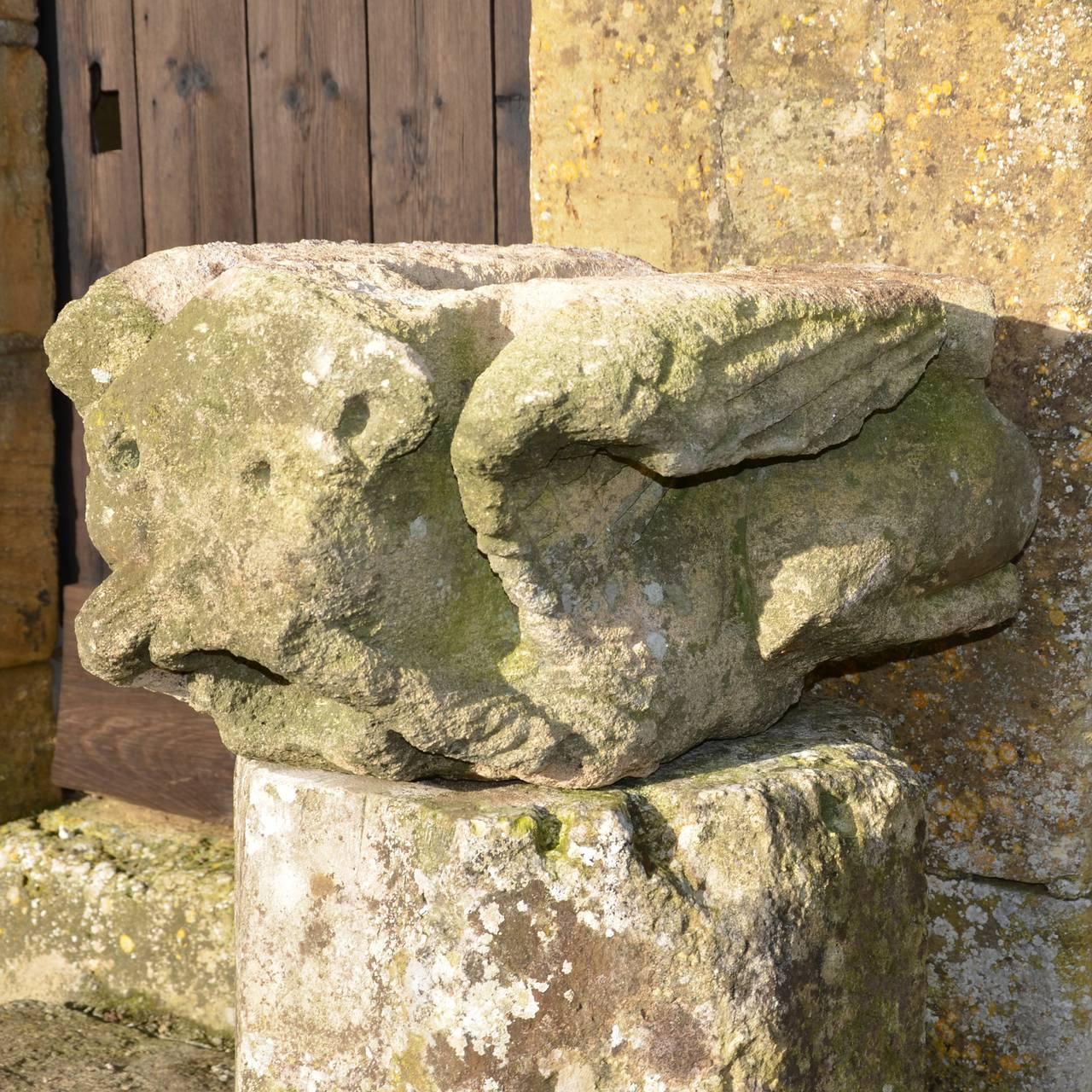 Large medieval carved limestone long fingered mouth puller
