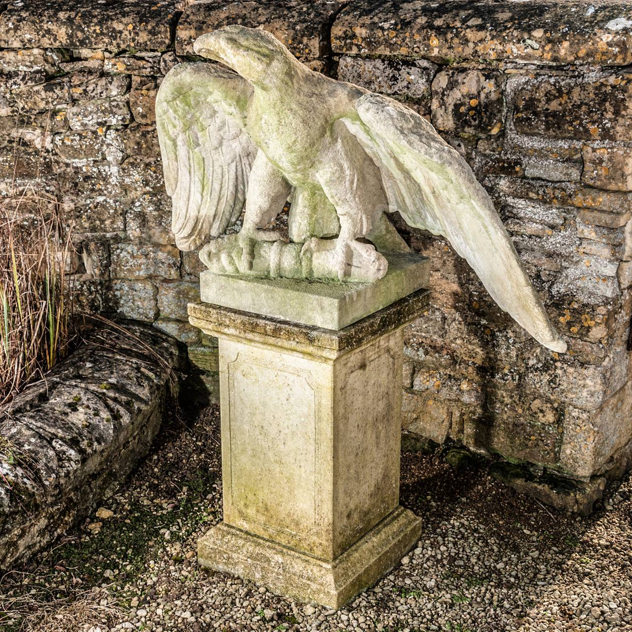 Pair of carved stone eagles for sale at stdibs