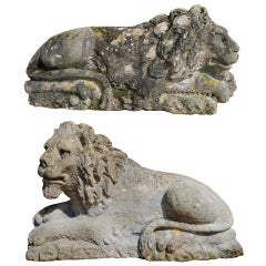 A pair of 19th century carved Bath stone lions after Canova