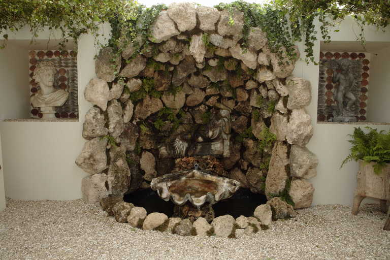 Tuffa rock and shell grotto with a 19th century marble for Garden grotto designs
