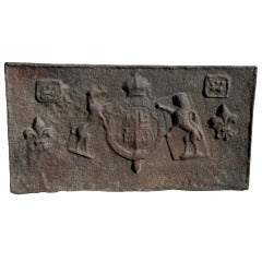 A cast iron fireback depicting lions rampant