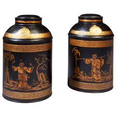 A Pair of Black Lacquer Chinoiserie and Gilt Tole Tea Jars