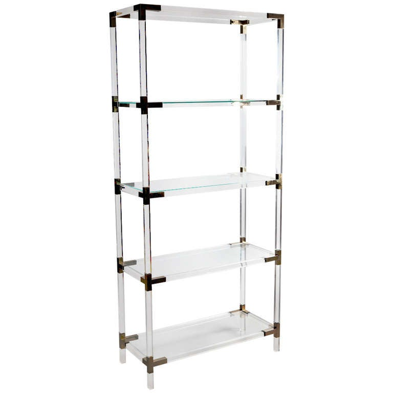 A Set of Brass Mounted Perspex Shelves 1