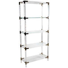 A Set of Brass Mounted Perspex Shelves