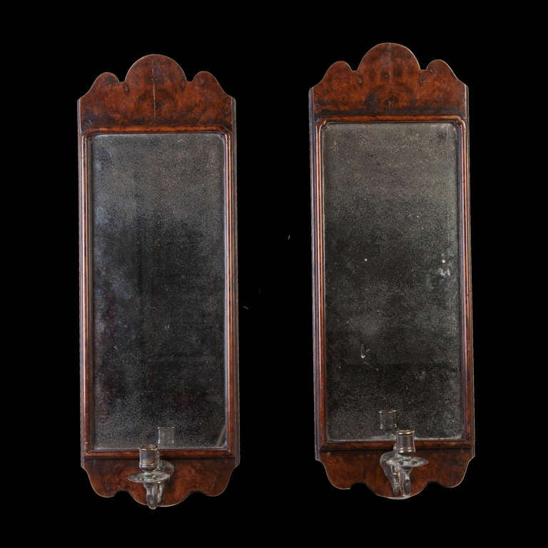 A pair of 19th century walnut wall sconce mirrors in the George I taste.