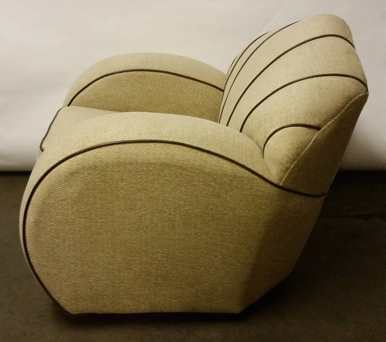 An awesome pair of Art Deco armchairs. We have had these fabulous armchairs re-upholstered in a light tweed with brown leather piping and they look marvelous. This great shape is accentuated with the contrasting piping. Dimensions: 80 cm H 96 cm