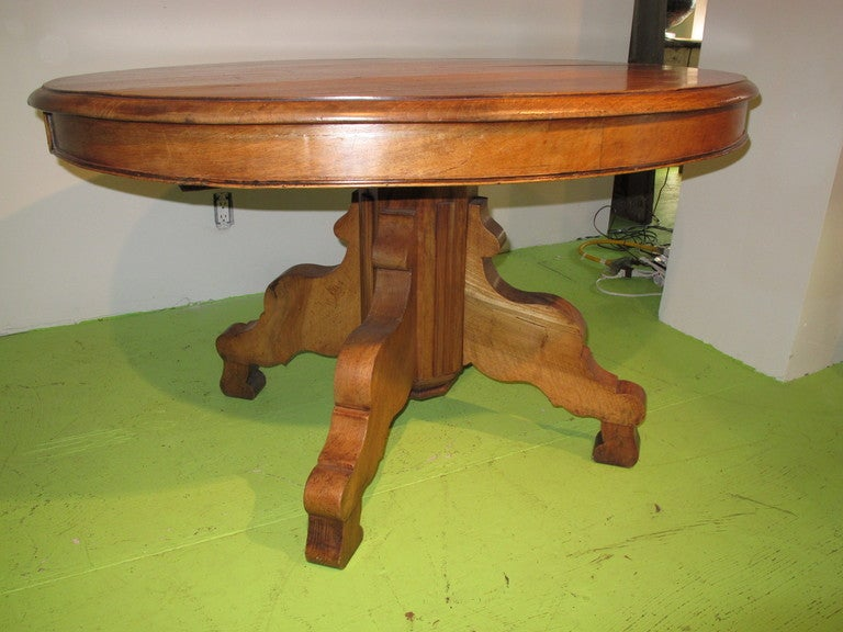 oval pedestal dining table with 2 large finished extension