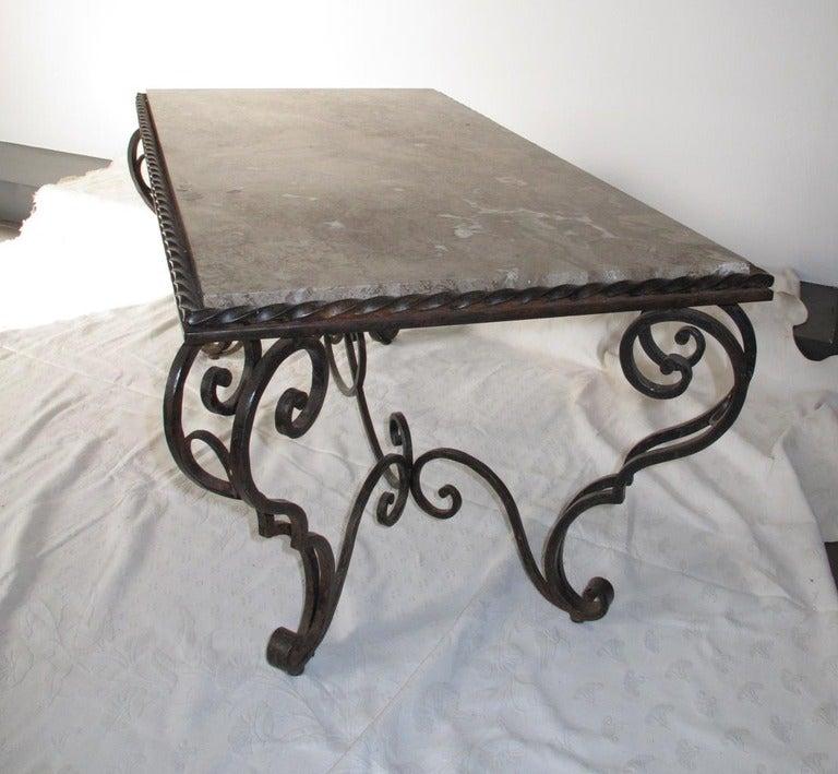 A rare, creamy brown marble on heavy, beautifully-wrought iron base, in classic early 20th Century style.
