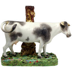 Massive Staffordshire Pearlware Pottery Figure of a Standing Cow on Colored Base