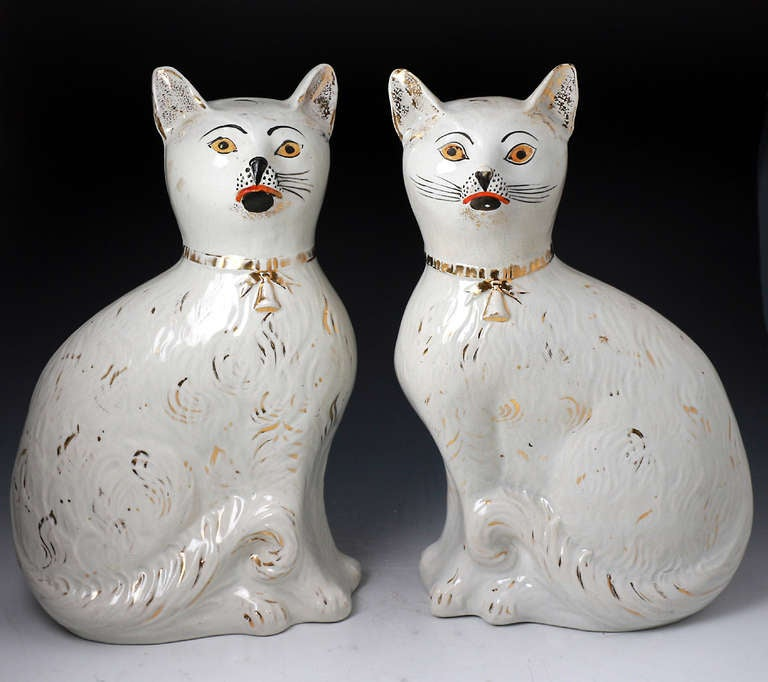 Antique pottery figures of seated cats Victorian period.  2