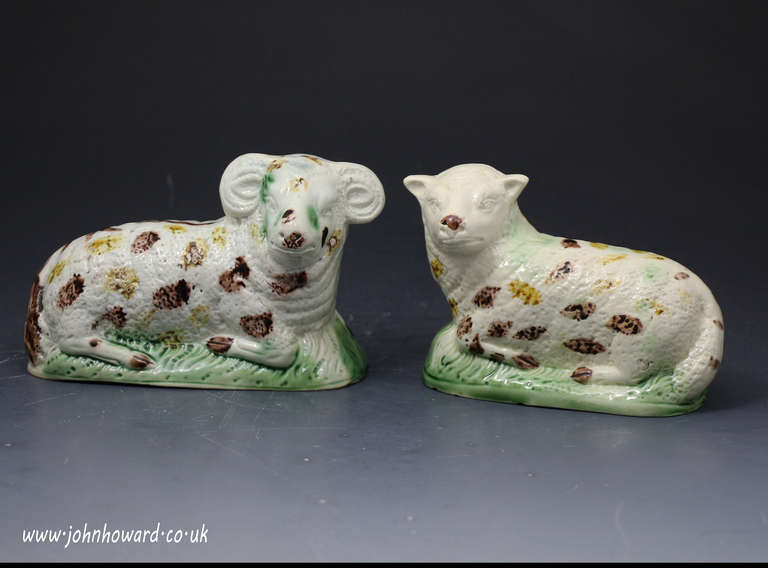 Antique pair of figures of a ewe and ram creamware bodied Yorkshire pottery c1790   Relief molded figures with coloured oxide decoartion underglaze. A naive and charming couple.