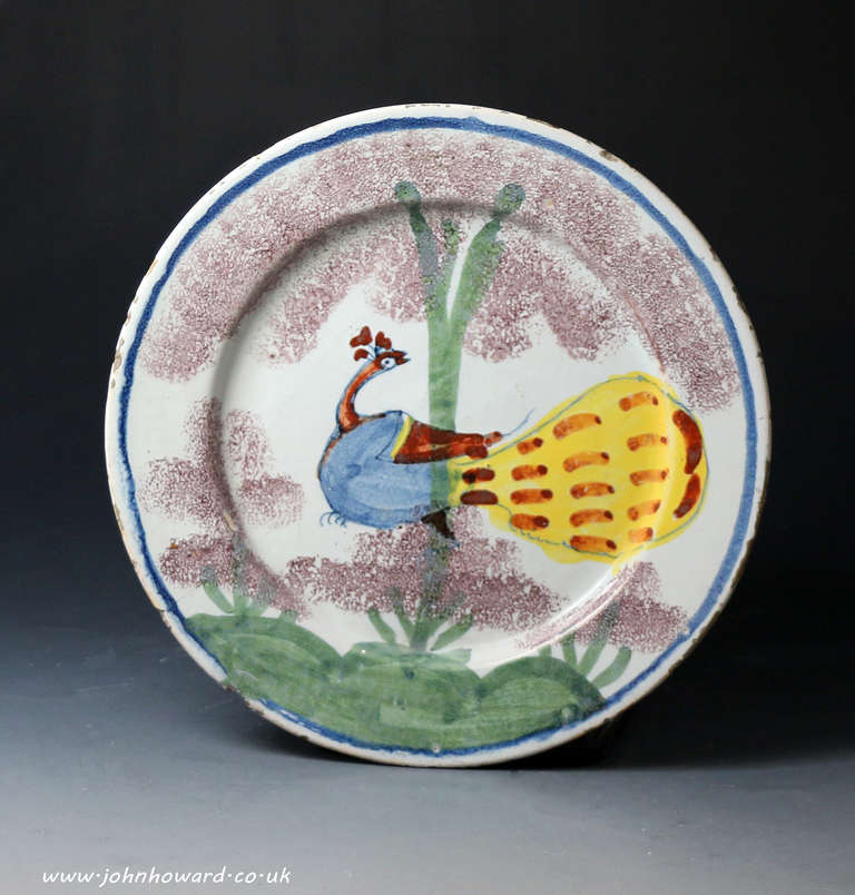 A highly decorative delftware polychrome plate decorated with a peacock perched somewhat comically in a tree & Bristol Pottery Delftware Plate Decorated in Polychrome with Peacock ...