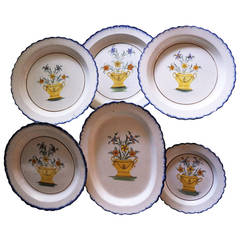 Collection Pearlware Chargers with Blue Shell Edge and Baskets of Flowers