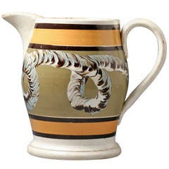 Early English or Welsh pottery mochaware pitcher with the earth worm pattern