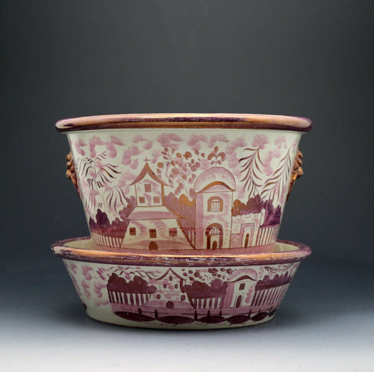 Antique English Staffordshire pottery jardiniere with original tray stand profusely decorated in pink luster. The scenes depict country houses and a church .They are wonderfully executed in the naive manner which 200 years later renders them as