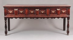 A fine William and Mary moulded front serving dresser