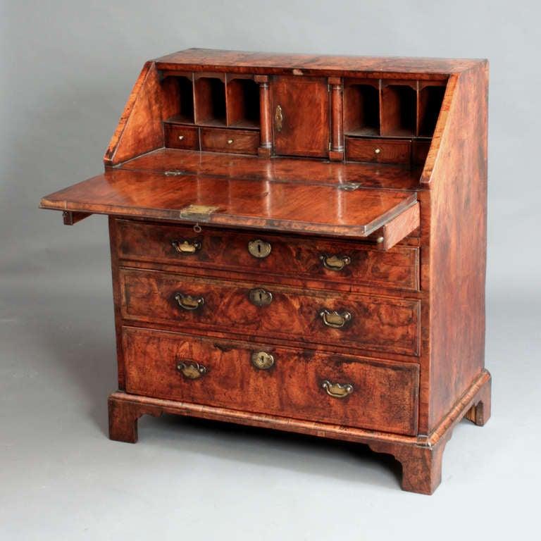 An early eighteenth century veneered walnut bureau of a good original colour and patina.
