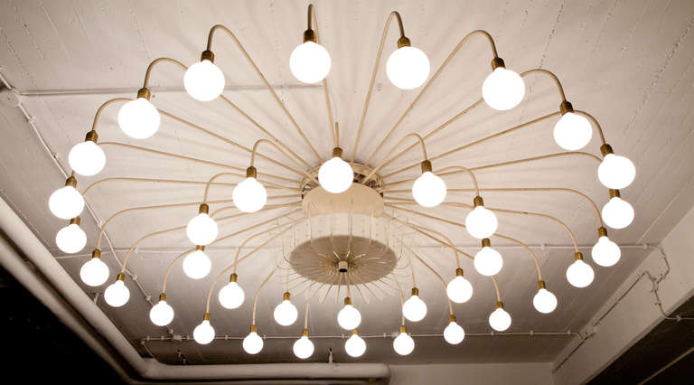 Beautiful and formidable ceiling lamp made of lacquered, zinc-plated steel pipes, with brass details and plexiglass. The lamp comes with 36 bulbs and it is made for a generous space and promises a stunning and unique effect.