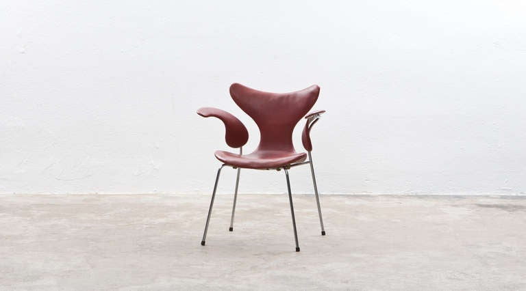 Read leather on chrome steel pipes Chair by Arne Jacobsen, Denmark, 1969.  Rare original Arne Jacobsen armchair named and known as 'Seagull'. The chair comes with original red colored leather on a chrome steel pipes frame. Manufactured by Fritz