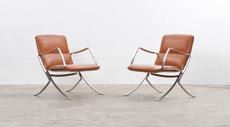 Pair of comfortable, dynamic looking lounge chairs designed by Jorgen Kastholm. The chairs are newly upholstered with high quality leather in cognac. In flattering condition, only the minimal patina from age and usage on the metal frame can tell