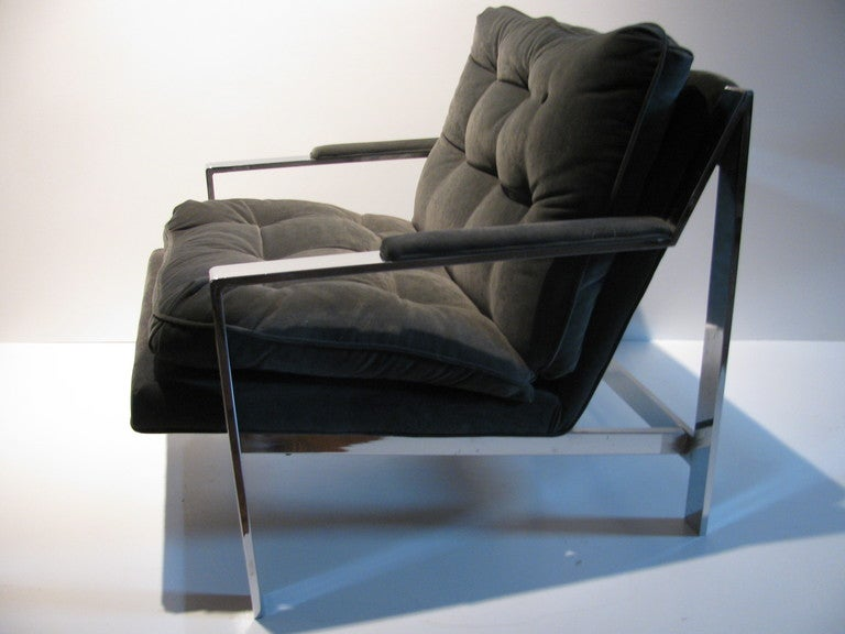 Pair of nickel chrome armchairs by Cy Mann and in the style of Milo Baughman. The chairs are the same, except for the upholstery and placement of arm pads. Chairs have exactly the same dimensions, and are in equal excellent condition. Presently they
