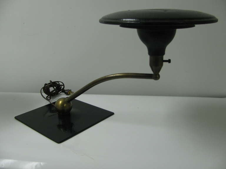 Classic M.G. Wheeler flying saucer lamp. Rare square base allows the lamp to pivot 360 degrees. Fabulous desk lamp. New wiring. Arm projects 21.5 in. Outward.