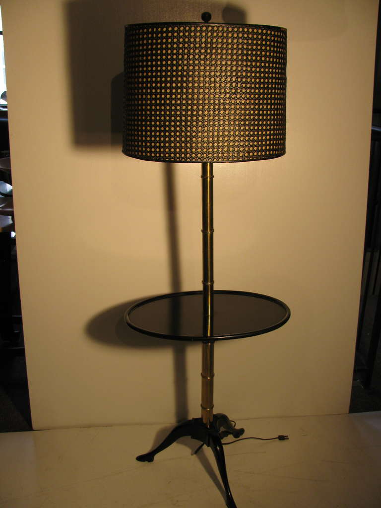 Stunning Elegant Black Lacquer Base With Actual Shoe Feet. Brass Faux Bamboo Shaft With Original Caned Shade. All Inquiries Please Call Or Just Press CONTACT DEALER Button.