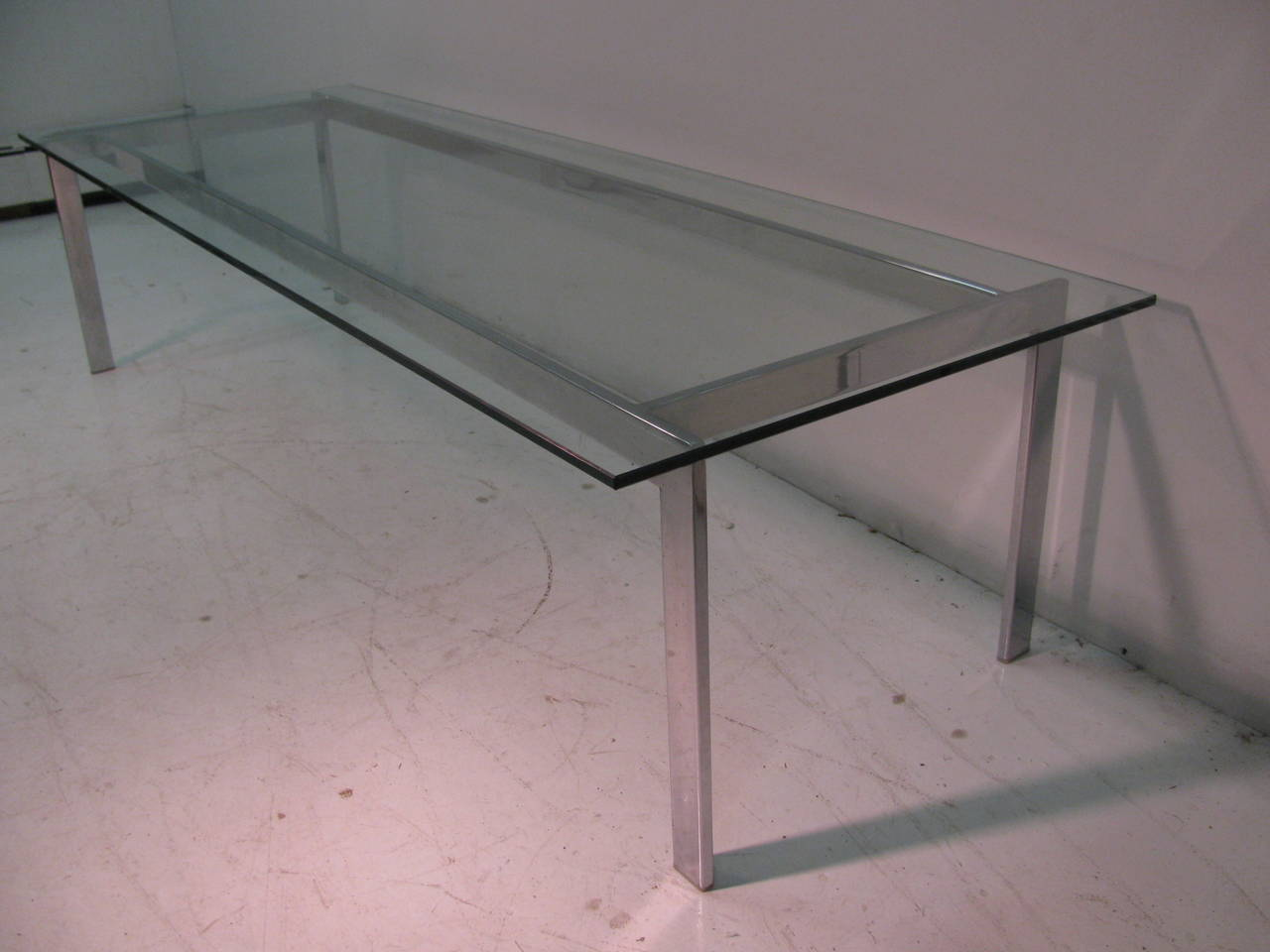 Elegant and simple architectural form created from nickel chrome steel with a glass top. Long and slender rectangle. All inquiries please call or just press
