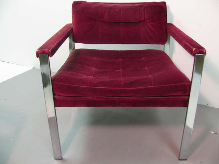 Beautifully designed pair of midcentury club lounge chairs. Comfort and great style. Gentle recline from front to back of seat. Full length arm pads. Chairs easily recovered. Upholstery service available.