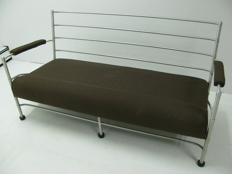 Beautiful and rare McArthur sofa created in the early thirties, an icon of the Hollywood era. His signature grid with aluminum curved tubing, tootsie roll armrests and black puck feet are all present on this sofa. Notched tubes and milled washers
