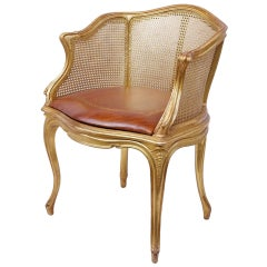 Elegant Louis XV Style Gilt and Caned Armchair