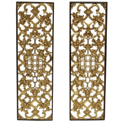 Pair of chinese sculpted and gilded panels, 19th century