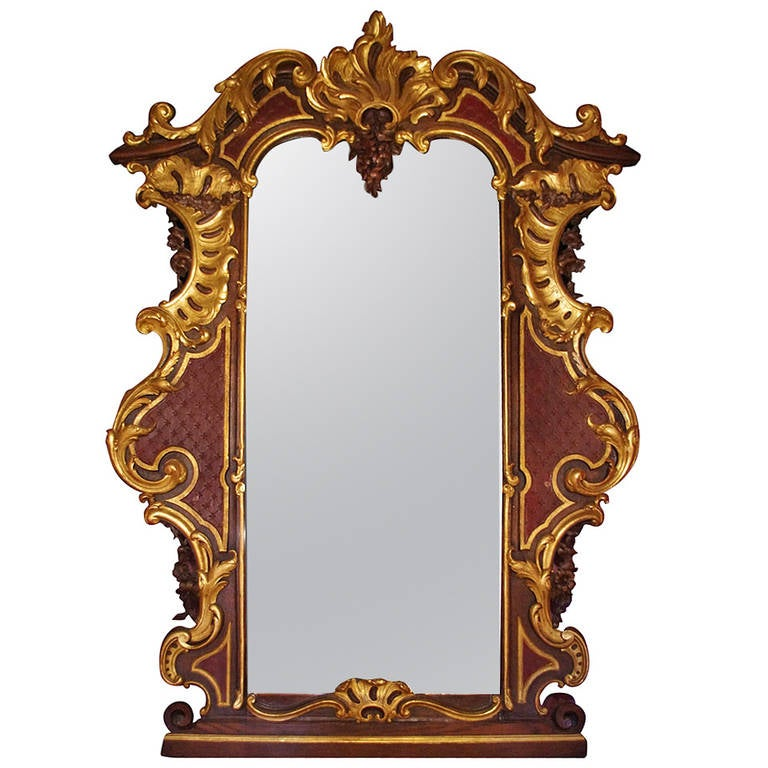 large rococo style mirror in gilt and painted oakwood