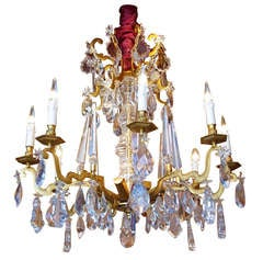 1940 Gilded bronze and crystal chandelier
