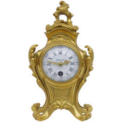 Small Rocaille clock in gilt and chiseled bronze signed PLANCHON from 1900